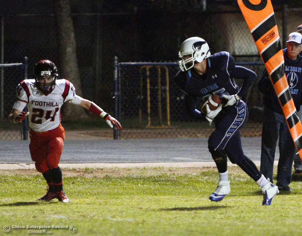 . Pleasant Valley High\'s #25 Ryan Steindorf (right) rushes against Foothill High in the second quarter of their football game at PVHS Asgard Yard Friday, October 11, 2013 in Chico, Calif.  (Jason Halley/Chico Enterprise-Record)