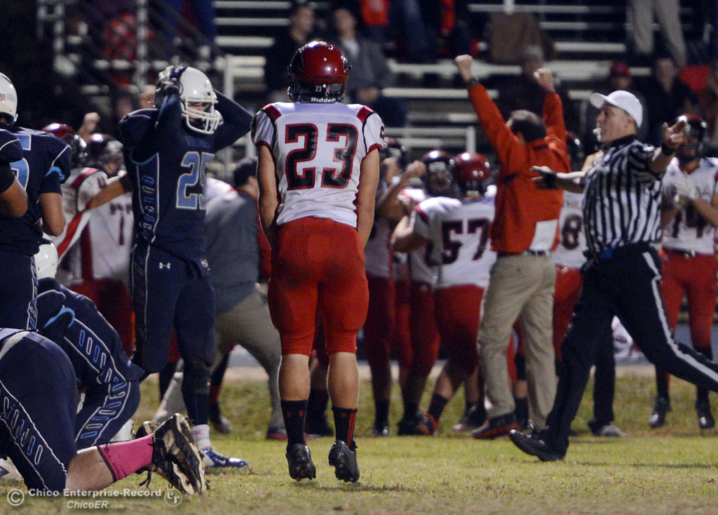 . Pleasant Valley High\'s #25 Ryan Steindorf reacts to a fumble recovered by  Foothill High in the fourth quarter of their football game at PVHS Asgard Yard Friday, October 11, 2013 in Chico, Calif.  (Jason Halley/Chico Enterprise-Record)