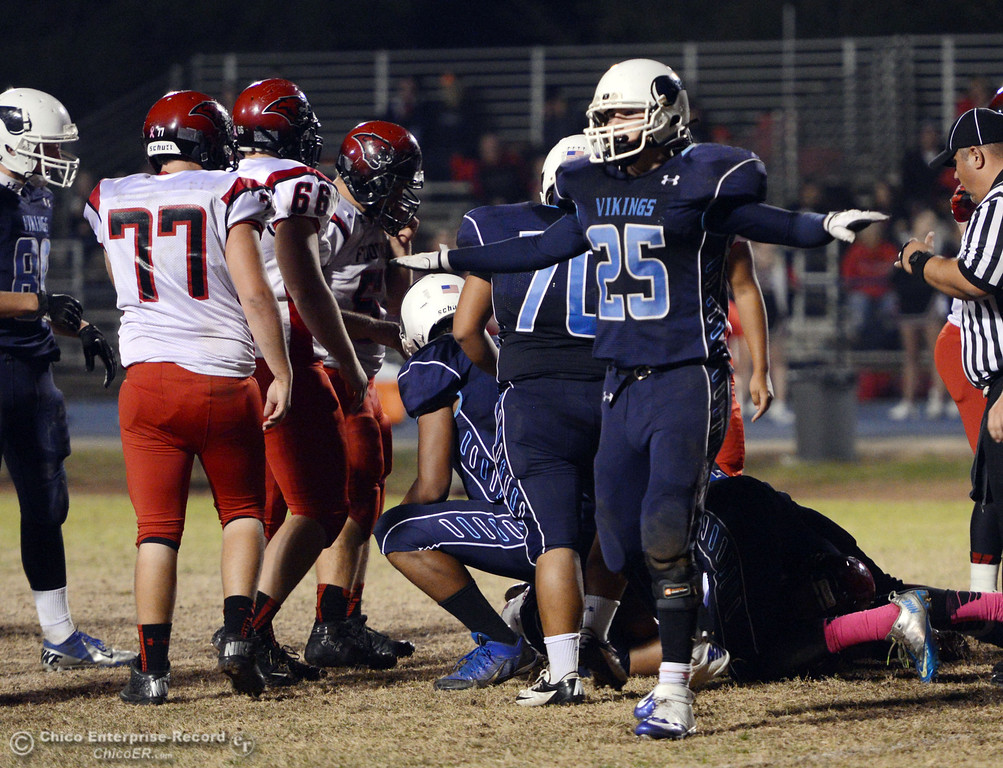 . Pleasant Valley High\'s #25 Ryan Steindorf reacts to a play against Foothill High in the second quarter of their football game at PVHS Asgard Yard Friday, October 11, 2013 in Chico, Calif.  (Jason Halley/Chico Enterprise-Record)