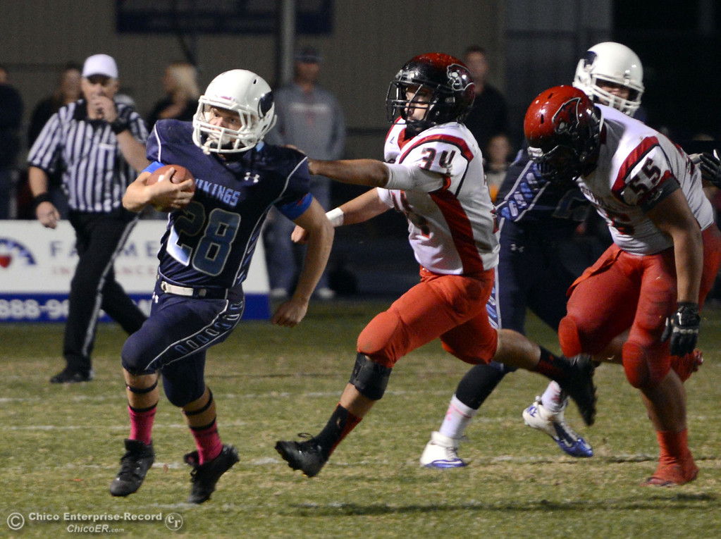 . Pleasant Valley High\'s #28 Dylan Batie (left) rushes against Foothill High in the third quarter of their football game at PVHS Asgard Yard Friday, October 11, 2013 in Chico, Calif.  (Jason Halley/Chico Enterprise-Record)