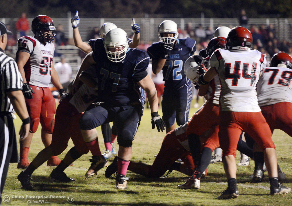 . Pleasant Valley High gestures for a touchdown against Foothill High in the fourth quarter of their football game at PVHS Asgard Yard Friday, October 11, 2013 in Chico, Calif.  (Jason Halley/Chico Enterprise-Record)