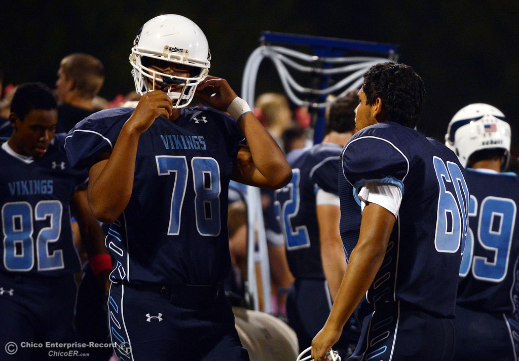 . Pleasant Valley High\'s #78 Alex Marquez (left) and #60 Sergio Mendoza (right) warm up against Foothill High in the first quarter of their football game at PVHS Asgard Yard Friday, October 11, 2013 in Chico, Calif.  (Jason Halley/Chico Enterprise-Record)