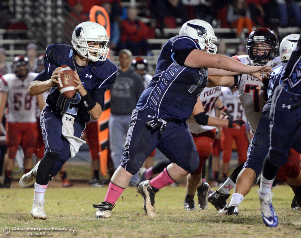 . Pleasant Valley High\'s #12 Trent Darms drops back to pass against Foothill High in the third quarter of their football game at PVHS Asgard Yard Friday, October 11, 2013 in Chico, Calif.  (Jason Halley/Chico Enterprise-Record)