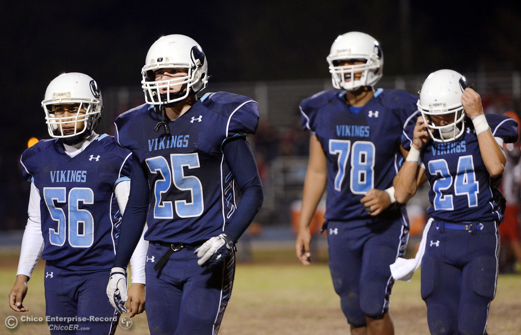 . Pleasant Valley High\'s #56 Zariel Torres, #25 Ryan Steindorf, #78 Alex Marquez, and #24 Jack Soza (left to right) come off the field against Foothill High in the second quarter of their football game at PVHS Asgard Yard Friday, October 11, 2013 in Chico, Calif.  (Jason Halley/Chico Enterprise-Record)