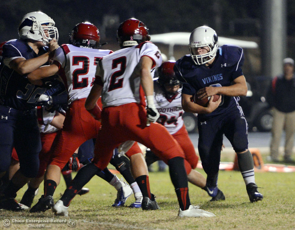 . Pleasant Valley High\'s #9 Houson McGowan (right) rushes against Foothill High in the second quarter of their football game at PVHS Asgard Yard Friday, October 11, 2013 in Chico, Calif.  (Jason Halley/Chico Enterprise-Record)