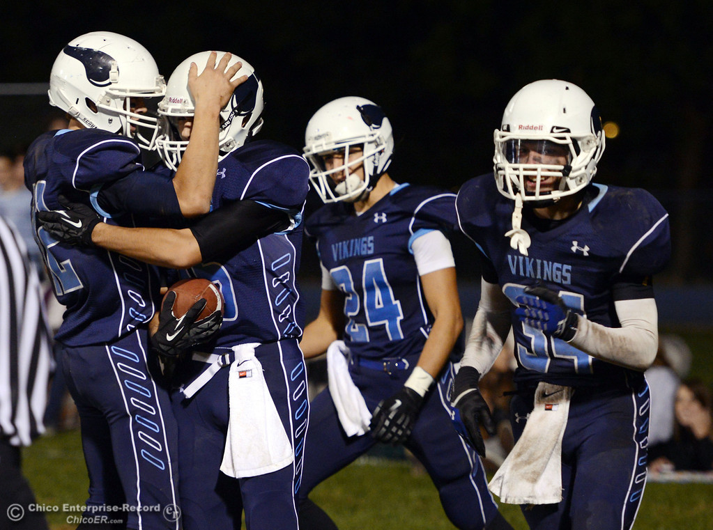 . Pleasant Valley High\'s #52 Riley Andrew congratulates #16 Trey Rosenbalm on scoring a touchdown next to #24 Jack Soza, and #34 Cale Crawford (left to right) against Foothill High in the third quarter of their football game at PVHS Asgard Yard Friday, October 11, 2013 in Chico, Calif.  (Jason Halley/Chico Enterprise-Record)