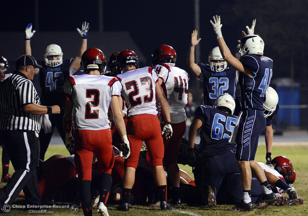 . Pleasant Valley High gestures a touchdown against Foothill High in the second quarter of their football game at PVHS Asgard Yard Friday, October 11, 2013 in Chico, Calif.  (Jason Halley/Chico Enterprise-Record)