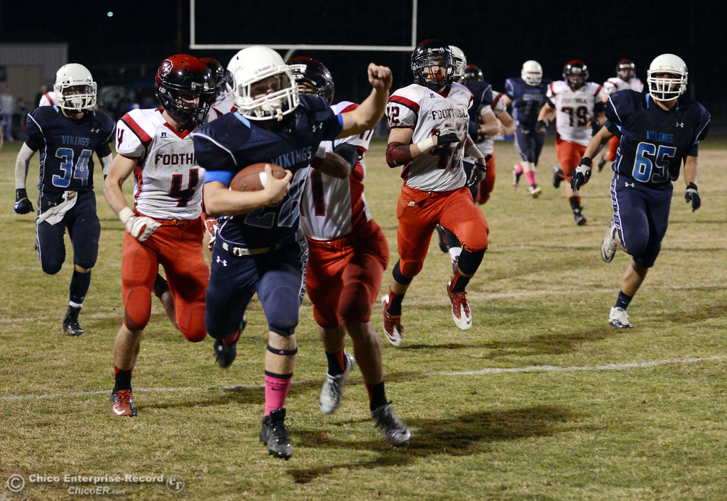 . Pleasant Valley High\'s #28 Dylan Batie (front) is tackled against Foothill High in the third quarter of their football game at PVHS Asgard Yard Friday, October 11, 2013 in Chico, Calif.  (Jason Halley/Chico Enterprise-Record)