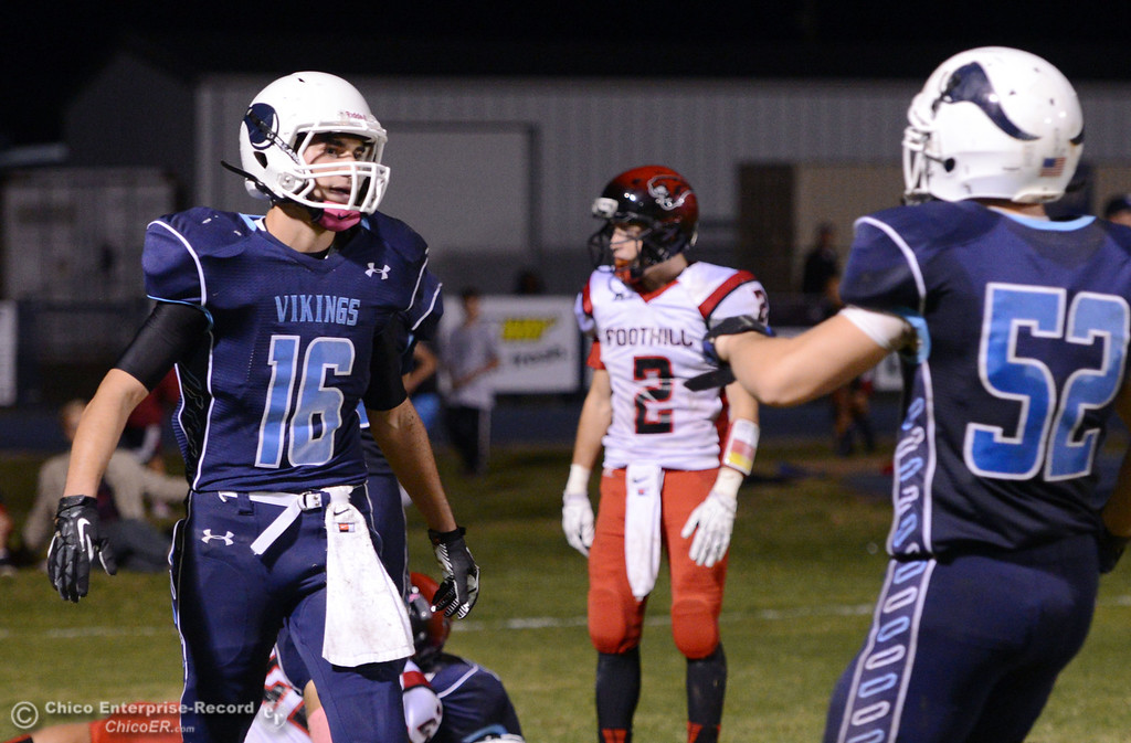 . Pleasant Valley High\'s #16 Trey Rosenbalm (left) and #52 Riley Andrew (right) against Foothill High in the fourth quarter of their football game at PVHS Asgard Yard Friday, October 11, 2013 in Chico, Calif.  (Jason Halley/Chico Enterprise-Record)