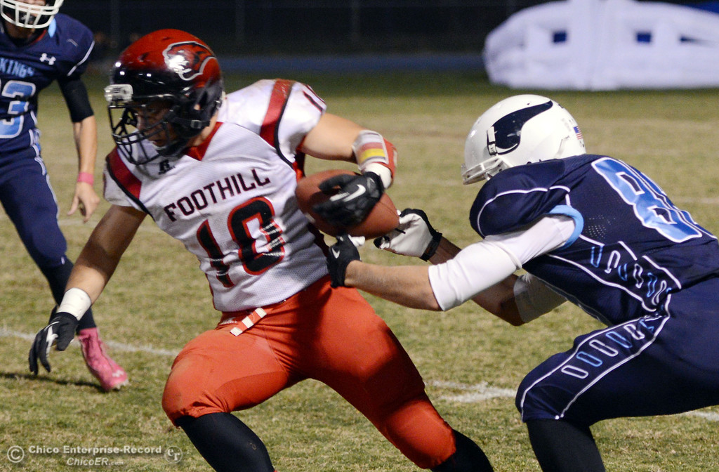 . Pleasant Valley High\'s #88 Zack Suttles (right) tackles against Foothill High\'s #10 Blake Burnett (left) in the first quarter of their football game at PVHS Asgard Yard Friday, October 11, 2013 in Chico, Calif.  (Jason Halley/Chico Enterprise-Record)