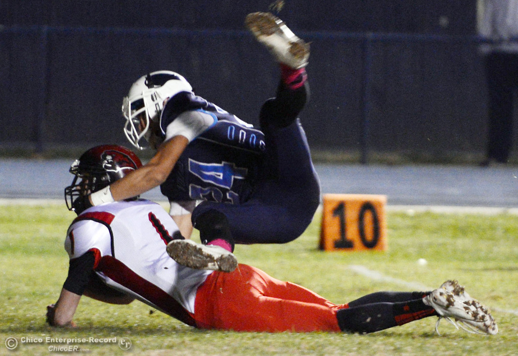 . Pleasant Valley High\'s #24 Jack Soza (top) tackles against Foothill High\'s #1 Matt Cox (bottom) in the third quarter of their football game at PVHS Asgard Yard Friday, October 11, 2013 in Chico, Calif.  (Jason Halley/Chico Enterprise-Record)
