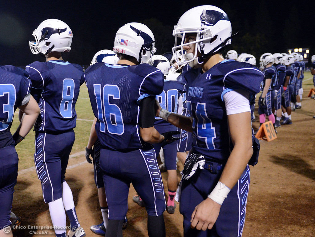 . Pleasant Valley High\'s #24 Jack Soza (right) looks on against Foothill High in the second quarter of their football game at PVHS Asgard Yard Friday, October 11, 2013 in Chico, Calif.  (Jason Halley/Chico Enterprise-Record)