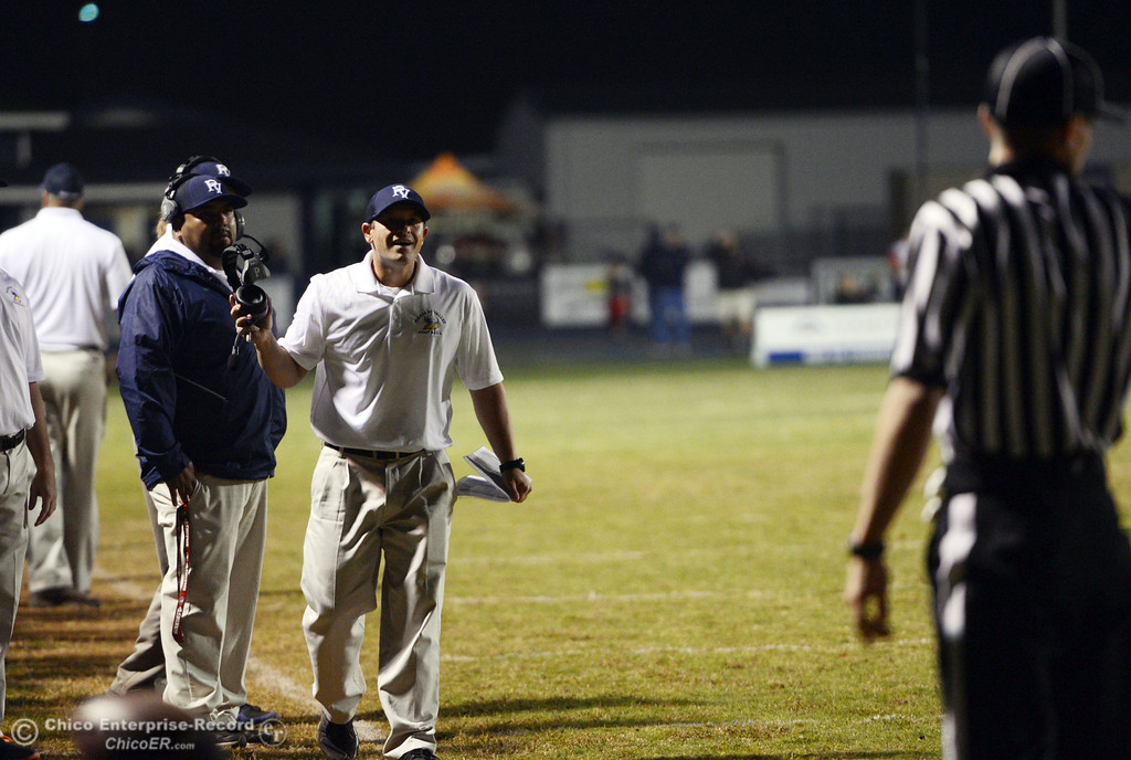 . Pleasant Valley High\'s coach Mark Cooley (right) reacts to a call against Foothill High in the second quarter of their football game at PVHS Asgard Yard Friday, October 11, 2013 in Chico, Calif.  (Jason Halley/Chico Enterprise-Record)