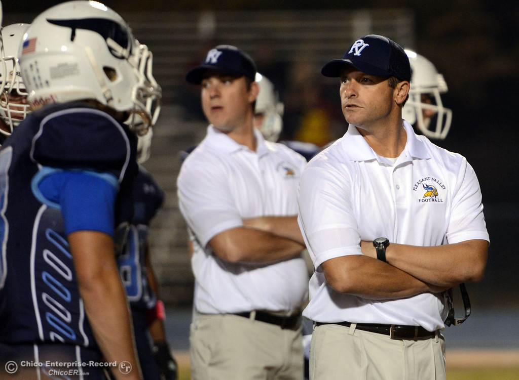 . Pleasant Valley High head coach Mark Cooley looks on against Foothill High before the first quarter of their football game at PVHS Asgard Yard Friday, October 11, 2013 in Chico, Calif.  (Jason Halley/Chico Enterprise-Record)