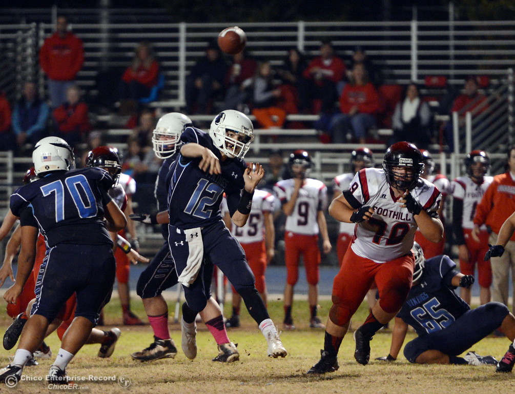 . Pleasant Valley High\'s #12 Trent Darms throws a pass against Foothill High in the third quarter of their football game at PVHS Asgard Yard Friday, October 11, 2013 in Chico, Calif.  (Jason Halley/Chico Enterprise-Record)