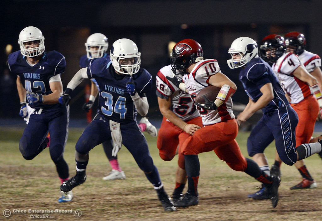 . Pleasant Valley High\'s #42 Chad Olsen, #34 Cale Crawford and #8 Brandon Beirman (left to right) tackle against Foothill High\'s #10 Blake Burnett (center) in the third quarter of their football game at PVHS Asgard Yard Friday, October 11, 2013 in Chico, Calif.  (Jason Halley/Chico Enterprise-Record)