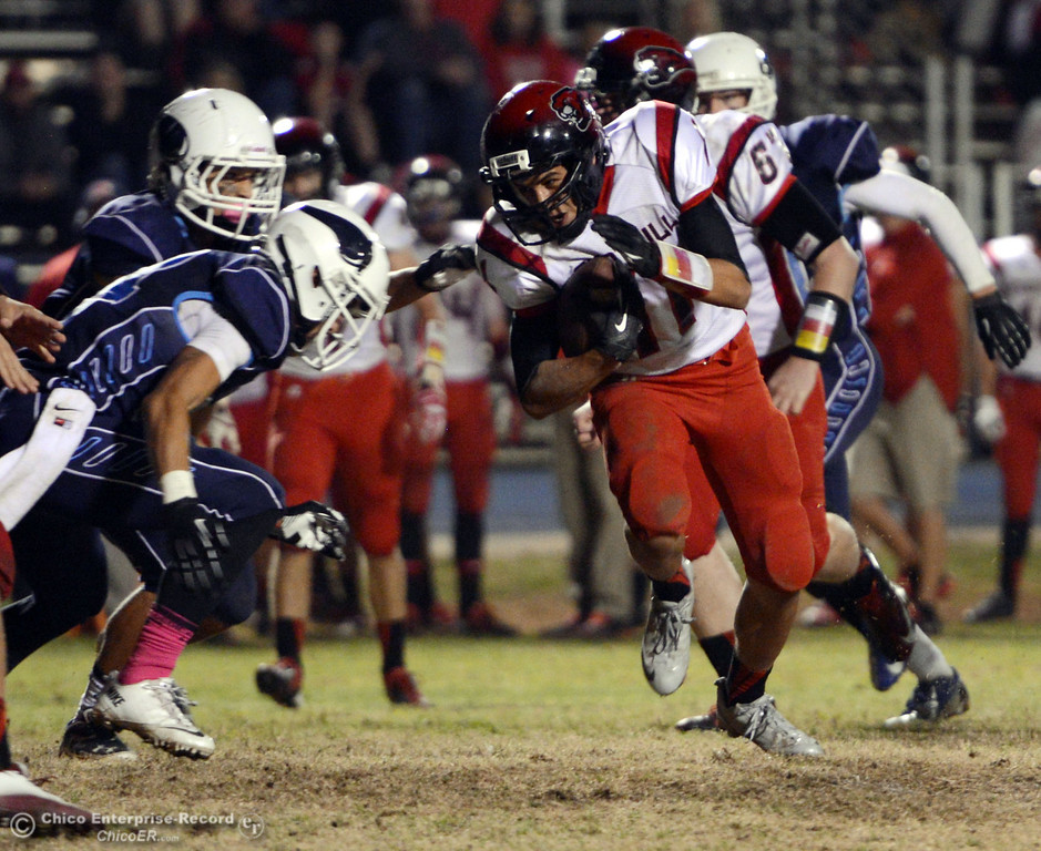 . Pleasant Valley Highs\' #34 Cale Crawford (left) tackles against Foothill High\'s #11 Ryan Terras (right) in the third quarter of their football game at PVHS Asgard Yard Friday, October 11, 2013 in Chico, Calif.  (Jason Halley/Chico Enterprise-Record)