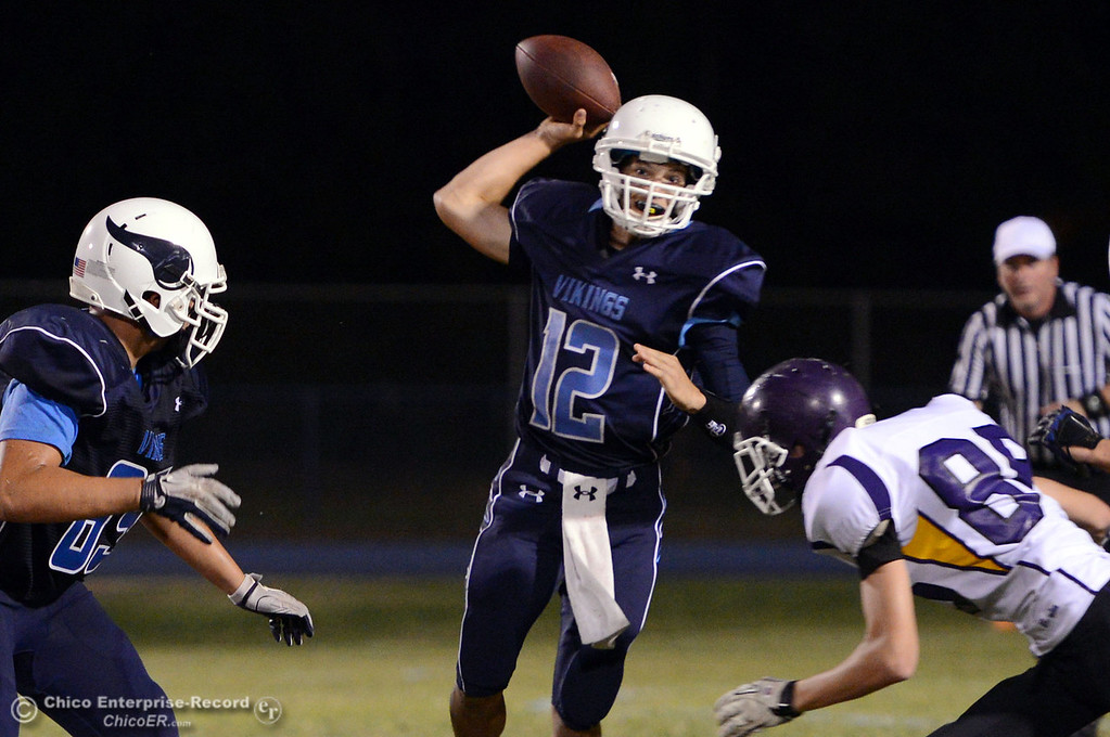. Pleasant Valley High\'s #12 Trent Darms throws under pressure against Lassen High in the second quarter of their football game at PVHS Asgard Yard Friday, September 6, 2013 in Chico, Calif. (Jason Halley/Chico Enterprise-Record)