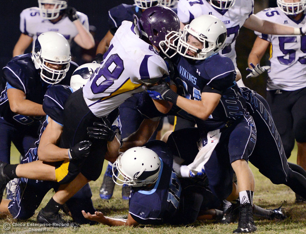 . Pleasant Valley High\'s #34 Cale Crawford (right) tackles against Lassen High\'s #48 Kyle Barnetche (left) in the third quarter of their football game at PVHS Asgard Yard Friday, September 6, 2013 in Chico, Calif. (Jason Halley/Chico Enterprise-Record)