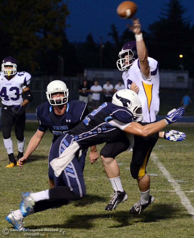 . Pleasant Valley High\'s #55 Tucker Stimac (left) watches #42 Chad Olsen (center) tackle Lassen High\'s #8 Jordan Atkinson (right) in the first quarter of their football game at PVHS Asgard Yard Friday, September 6, 2013 in Chico, Calif. (Jason Halley/Chico Enterprise-Record)