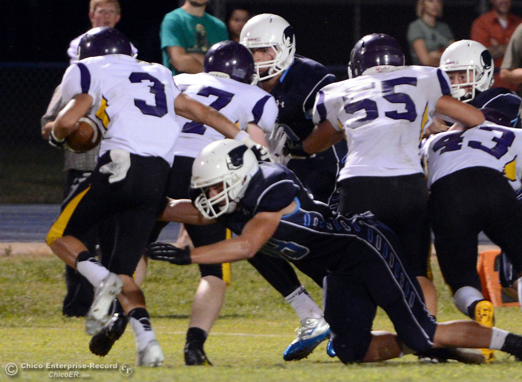 . Pleasant Valley High\'s #88 Zack Suttles (right) tackles against Lassen High\'s #3 Quinn Thompson (left) during the second quarter of their football game at PVHS Asgard Yard on Friday, September 6, 2013 in Chico, Calif.  (Jason Halley/Chico Enterprise-Record)