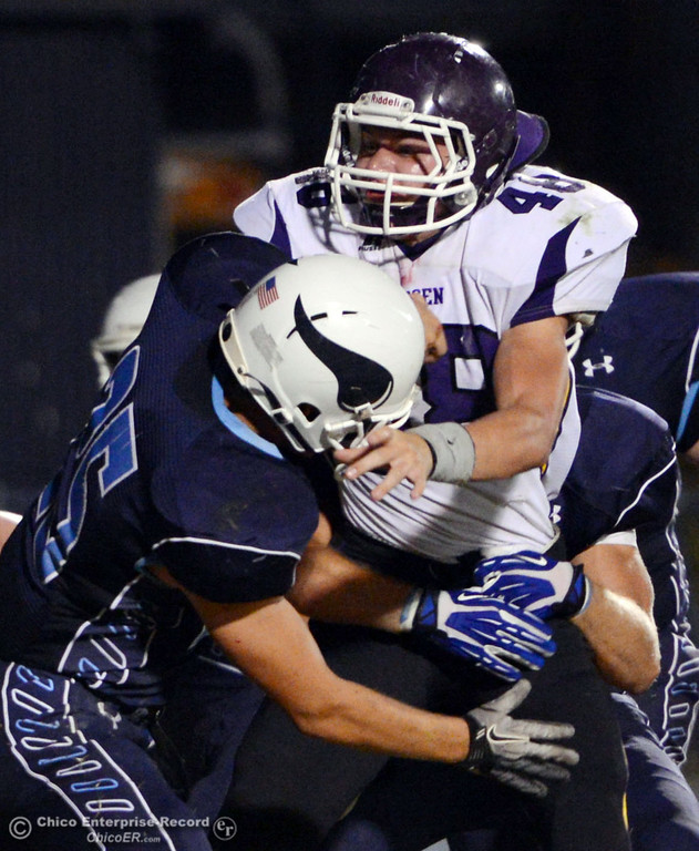 . Pleasant Valley High\'s #25 Ryan Steindorf (left) tackles against Lassen High\'s #48 Kyle Barnetche (right) in the first quarter of their football game at PVHS Asgard Yard Friday, September 6, 2013 in Chico, Calif. (Jason Halley/Chico Enterprise-Record)