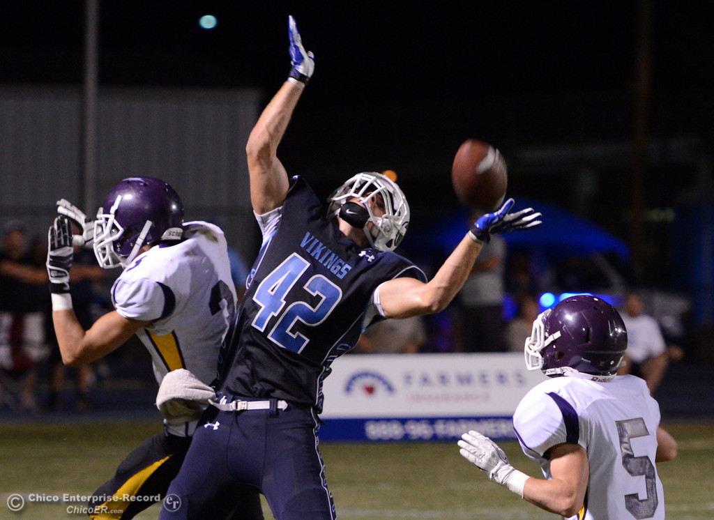 . Pleasant Valley High\'s #42 Chad Olsen (center) is unable to make a catch against Lassen High\'s #3 Quinn Thompson (left) and #5 Trey Oltjenbruns (right) in the second quarter of their football game at PVHS Asgard Yard Friday, September 6, 2013 in Chico, Calif. (Jason Halley/Chico Enterprise-Record)