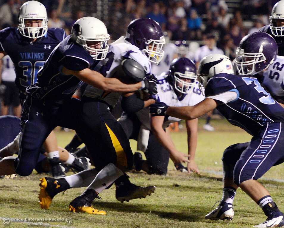 . Pleasant Valley High\'s #88 Zack Suttles (left) and #3 Brandon Romero (right) tackle against Lassen High\'s #43 Case Bennett (center) in the second quarter of their football game at PVHS Asgard Yard Friday, September 6, 2013 in Chico, Calif. (Jason Halley/Chico Enterprise-Record)