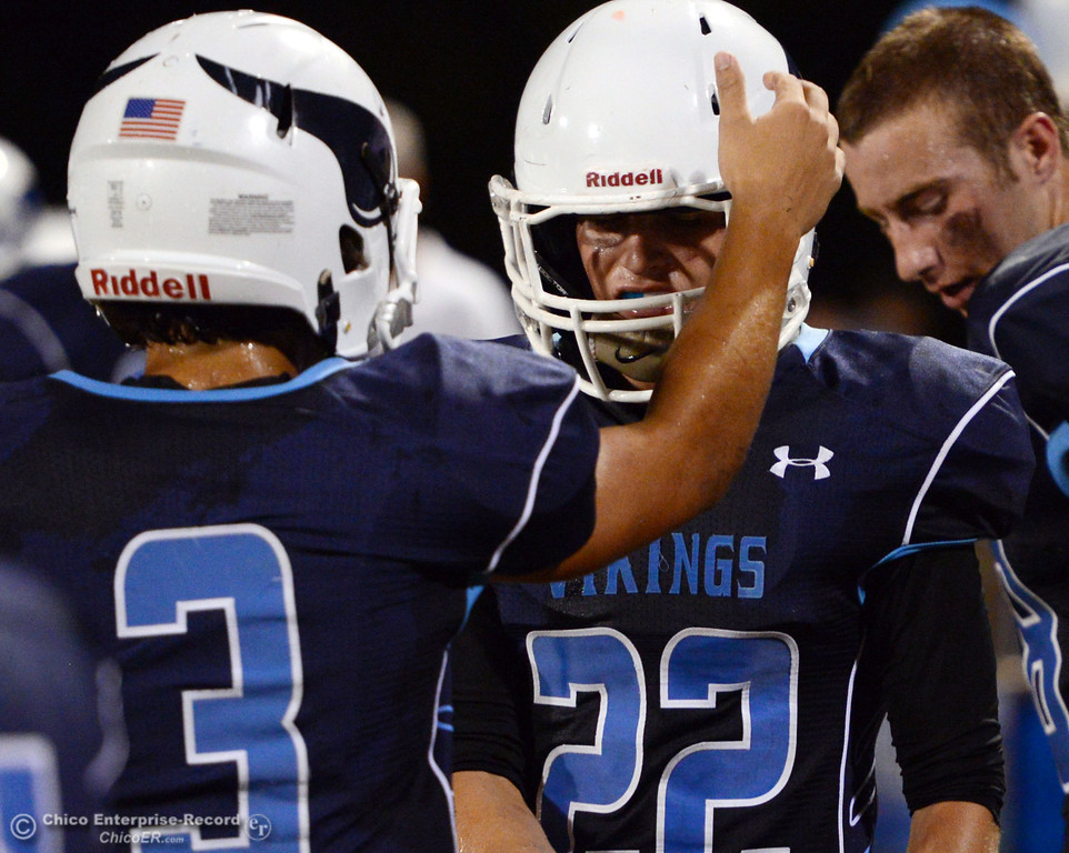 . Pleasant Valley High\'s #3 Brandon Romero (left) talks to #22 Jake Dani (right) against Lassen High in the second quarter of their football game at PVHS Asgard Yard Friday, September 6, 2013 in Chico, Calif. (Jason Halley/Chico Enterprise-Record)