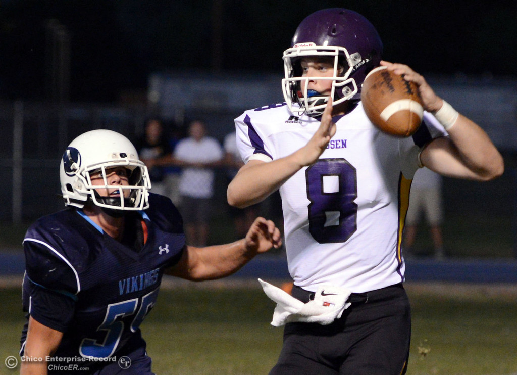 . Pleasant Valley High\'s #55 Tucker Stimac (left) defends against Lassen High\'s #8 Jordan Atkinson (right) in the first quarter of their football game at PVHS Asgard Yard Friday, September 6, 2013 in Chico, Calif. (Jason Halley/Chico Enterprise-Record)