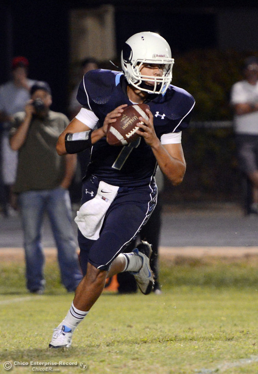 . Pleasant Valley High\'s #7 Zane Ferguson drops back to pass against Lassen High in the fourth quarter of their football game at PVHS Asgard Yard Friday, September 6, 2013 in Chico, Calif. (Jason Halley/Chico Enterprise-Record)