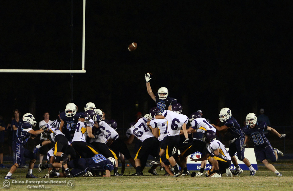 . Pleasant Valley High attempts to block the extra point against Lassen High in the fourth quarter of their football game at PVHS Asgard Yard Friday, September 6, 2013 in Chico, Calif. (Jason Halley/Chico Enterprise-Record)