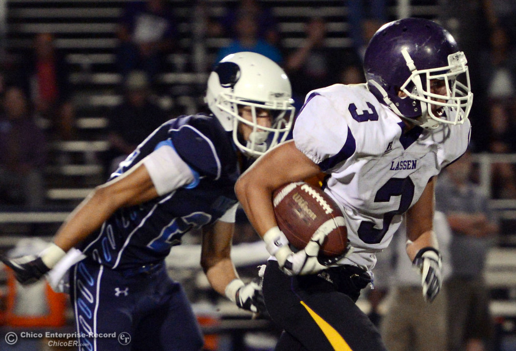 . Pleasant Valley High\'s #24 Jack Soza (left) defends against Lassen High\'s #3 Quinn Thompson (right) in the third quarter of their football game at PVHS Asgard Yard Friday, September 6, 2013 in Chico, Calif. (Jason Halley/Chico Enterprise-Record)