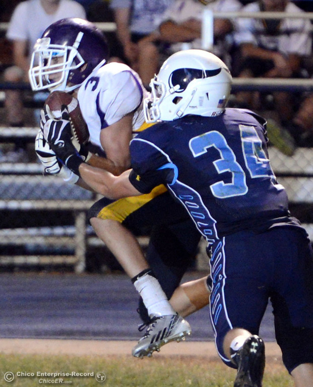 . Pleasant Valley High\'s #34 Cale Crawford (right) is unable to break up an intercept by Lassen High\'s #3 Quinn Thompson (left) in the fourth quarter of their football game at PVHS Asgard Yard Friday, September 6, 2013 in Chico, Calif. (Jason Halley/Chico Enterprise-Record)