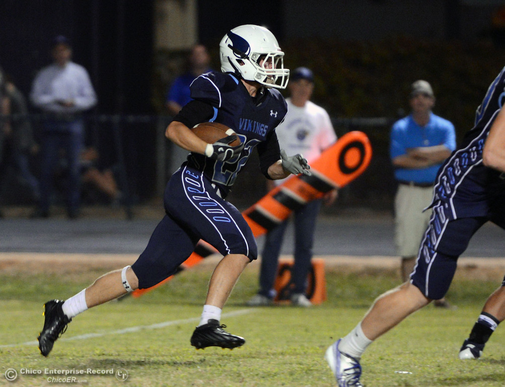 . Pleasant Valley High\'s #22 Jake Dani rushes against Lassen High in the first quarter of their football game at PVHS Asgard Yard Friday, September 6, 2013 in Chico, Calif. (Jason Halley/Chico Enterprise-Record)