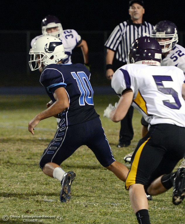 . Pleasant Valley High\'s #10 Tucker LaRue (left) completes a catch against Lassen High in the second quarter of their football game at PVHS Asgard Yard Friday, September 6, 2013 in Chico, Calif. (Jason Halley/Chico Enterprise-Record)