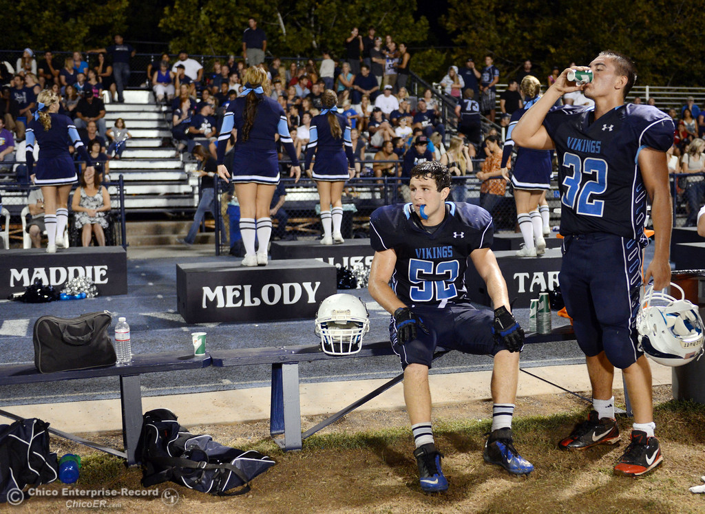 . Pleasant Valley High\'s #52 Riley Andrew (left) and #32 Jon Acevedo (right) on the sidelines against Lassen High in the third quarter of their football game at PVHS Asgard Yard Friday, September 6, 2013 in Chico, Calif. (Jason Halley/Chico Enterprise-Record)