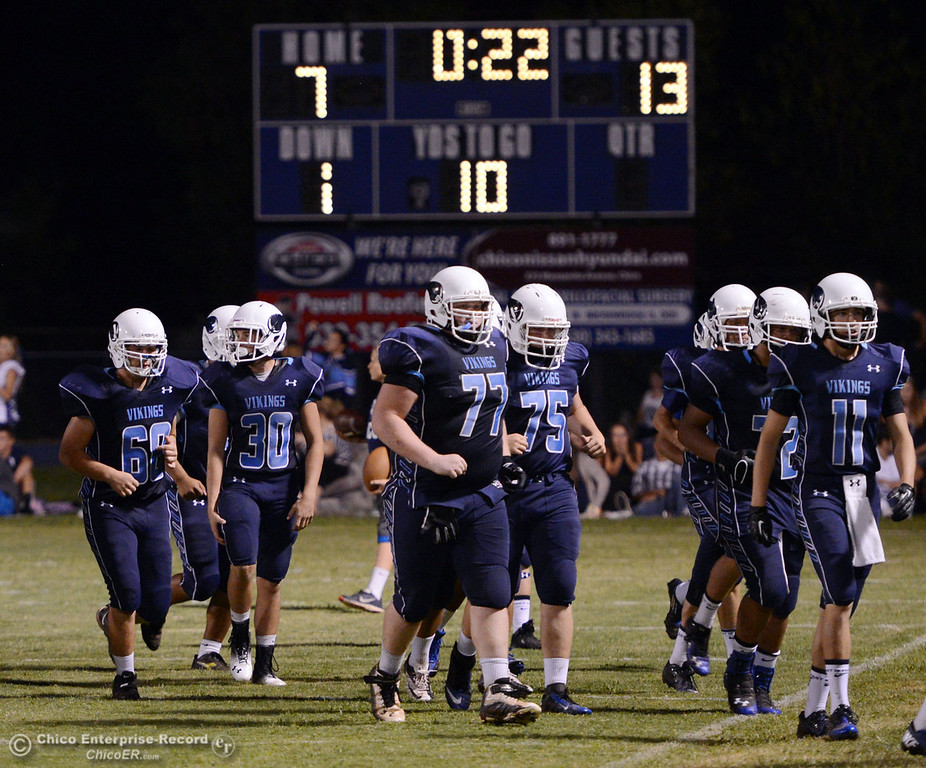 . Pleasant Valley High team takes the field against Lassen High in the third quarter of their football game at PVHS Asgard Yard Friday, September 6, 2013 in Chico, Calif. (Jason Halley/Chico Enterprise-Record)