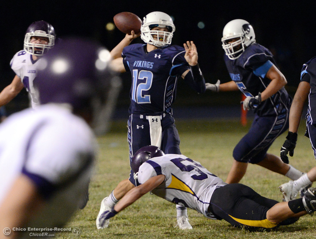. Pleasant Valley High\'s #12 Trent Darms throws under pressure against Lassen High in the fourth quarter of their football game at PVHS Asgard Yard Friday, September 6, 2013 in Chico, Calif. (Jason Halley/Chico Enterprise-Record)