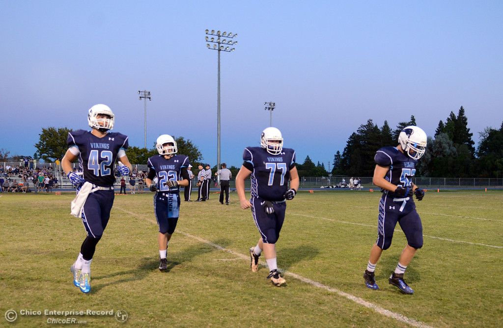 . Pleasant Valley High\'s #42 Chad Olsen, #22 Jake Dani, #77 Tyler Stimac, and #52 Riley Andrew (left to right) ready against Lassen High before the first quarter of their football game at PVHS Asgard Yard Friday, September 6, 2013 in Chico, Calif. (Jason Halley/Chico Enterprise-Record)