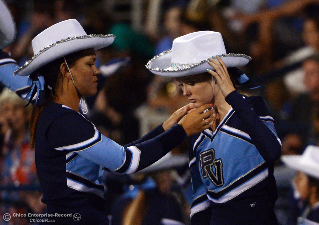 . Pleasant Valley High cheerleaders put on cowboy hats as they cheer against Lassen High in the second quarter of their football game at PVHS Asgard Yard Friday, September 6, 2013 in Chico, Calif. (Jason Halley/Chico Enterprise-Record)
