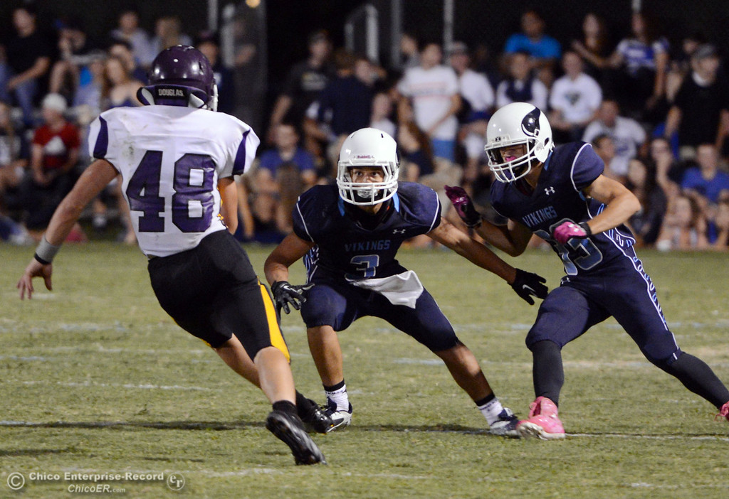 . Pleasant Valley High\'s #3 Brandon Romero (center) and #33 Taylor Wright (right) defend against Lassen High\'s #48 Kyle Barnetche (left) in the second quarter of their football game at PVHS Asgard Yard Friday, September 6, 2013 in Chico, Calif. (Jason Halley/Chico Enterprise-Record)