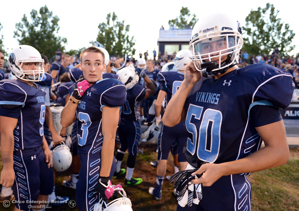 . Pleasant Valley High\'s #50 Kyle Felix (right) looks on against Lassen High before the first quarter of their football game at PVHS Asgard Yard Friday, September 6, 2013 in Chico, Calif. (Jason Halley/Chico Enterprise-Record)