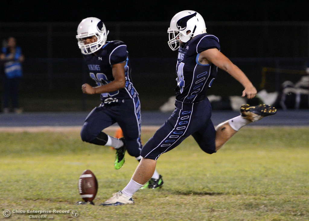 . Pleasant Valley High\'s #54 Zack Gillam (right) kicks off against Lassen High in the third quarter of their football game at PVHS Asgard Yard Friday, September 6, 2013 in Chico, Calif. (Jason Halley/Chico Enterprise-Record)