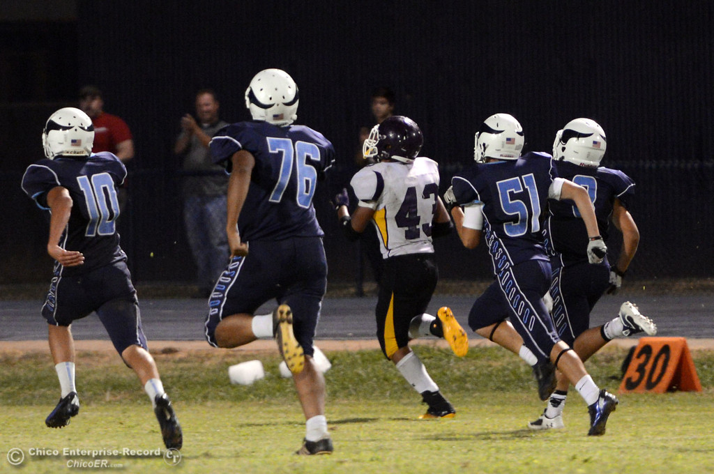 . Pleasant Valley High can\'t stop against Lassen High\'s #43 Case Bennett touchdown run in the fourth quarter of their football game at PVHS Asgard Yard Friday, September 6, 2013 in Chico, Calif. (Jason Halley/Chico Enterprise-Record)