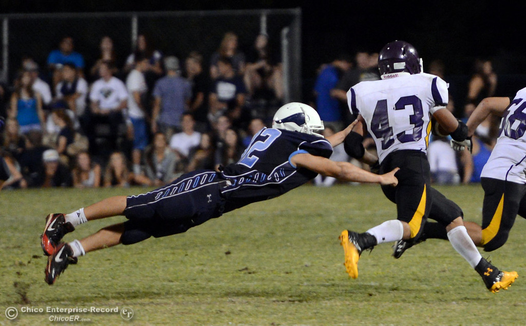 . Pleasant Valley High\'s #32 Jon Acevedo (left) attempts to tackle against Lassen High\'s #43 Case Bennett (right) in the second quarter of their football game at PVHS Asgard Yard Friday, September 6, 2013 in Chico, Calif. (Jason Halley/Chico Enterprise-Record)