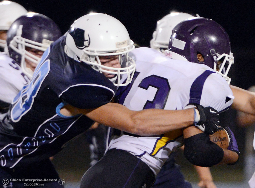 . Pleasant Valley High\'s #88 Zack Stuttles (left) tackles against Lassen High\'s #43 Case Bennett (right) in the second quarter of their football game at PVHS Asgard Yard Friday, September 6, 2013 in Chico, Calif. (Jason Halley/Chico Enterprise-Record)