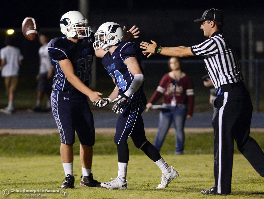 . Pleasant Valley High\'s #68 Jacob Gregg (left) congratulates #44 Clyand Leitner (right) on scoring a touchdown against Oroville High in the second quarter of their football game at PVHS Asgard Yard Friday, September 20, 2013, in Chico, Calif. (Jason Halley/Chico Enterprise-Record)