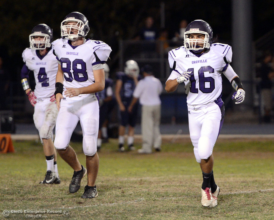 . Pleasant Valley High against Oroville High\'s #4 Antony Ramsey, #88 Bryce Secrist, #16 Oscar Ruiz (left to right) in the fourth quarter of their football game at PVHS Asgard Yard Friday, September 20, 2013, in Chico, Calif. (Jason Halley/Chico Enterprise-Record)