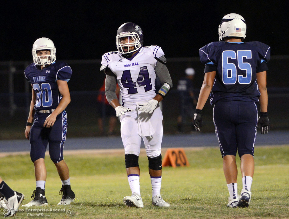 . Pleasant Valley High\'s #30 Connor Melton (left) and #65 Michael Walker (right) against Oroville High\'s #44 Derrek Gordon (center) in the first quarter of their football game at PVHS Asgard Yard Friday, September 20, 2013, in Chico, Calif. (Jason Halley/Chico Enterprise-Record)